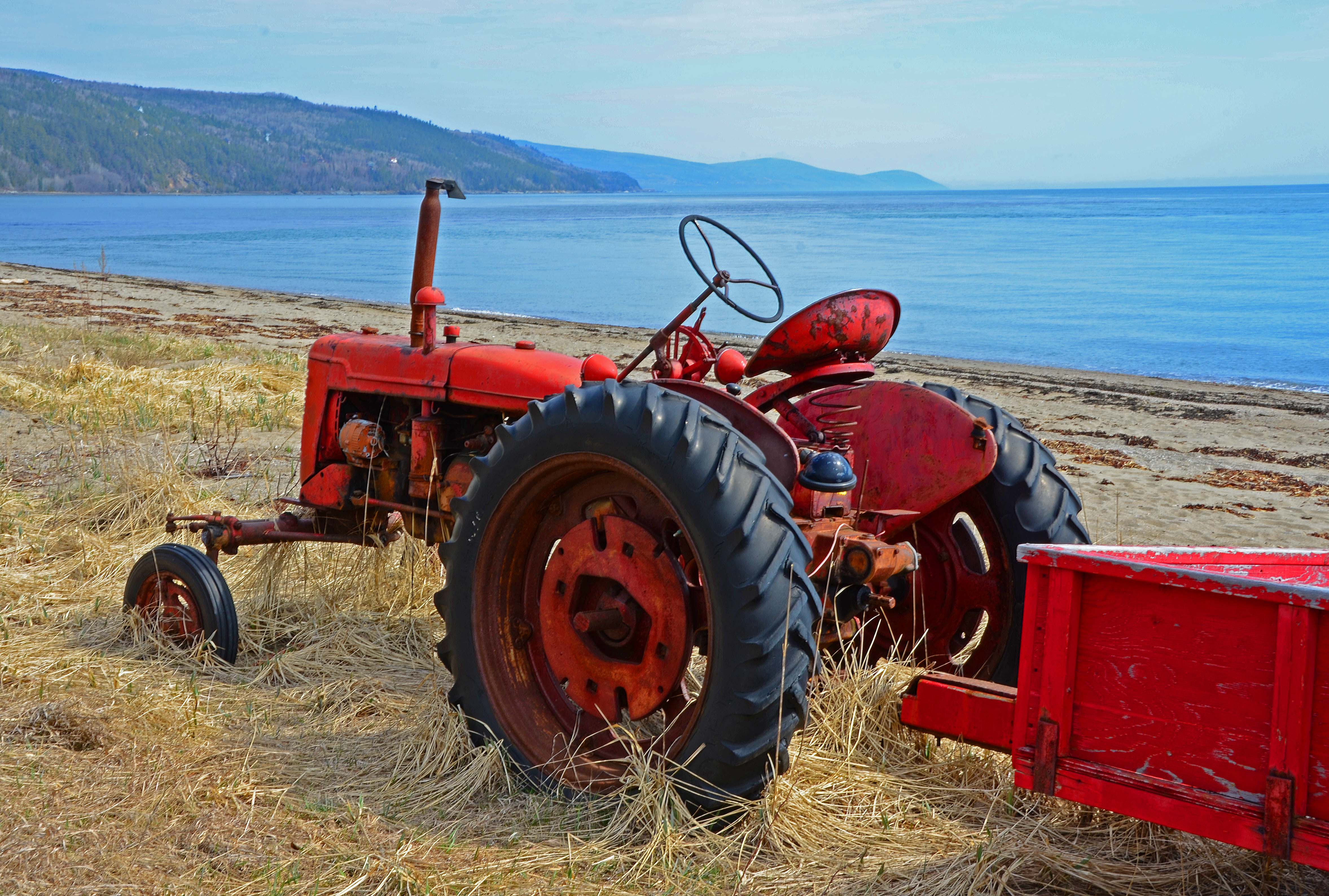 Old Farm Tractors : Old farm tractor along charlevoix st lawrence shore « o
