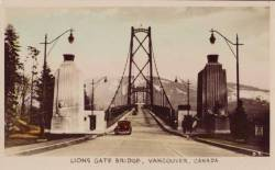 About 1940. Non-traditional focus for a bridge image. Neat old auto coming toward the viewer.