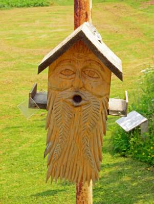 Grizzled Face Birdhouse, by David Taylor